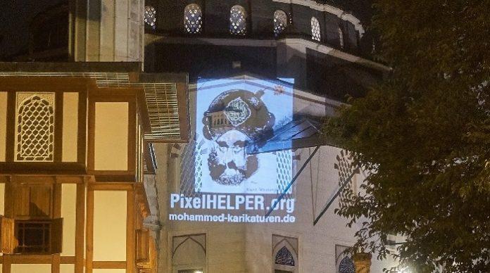 Kolín nad Rýnem: Policie zakázala pietní shromáždění s promítáním karikatur Mohameda